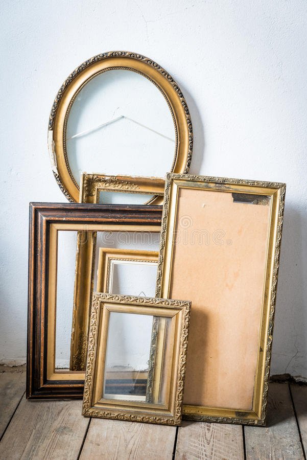 Old paintings frames. Old wooden painting frames in painter studio stock photos