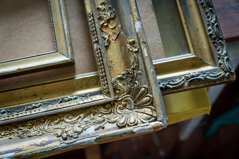 Old paintings frames. Old wooden painting frames in painter studio royalty free stock image
