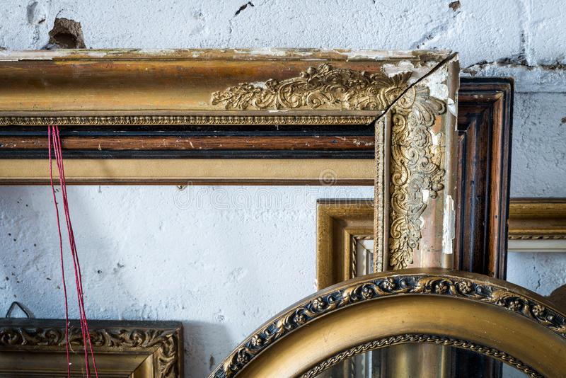 Old paintings frames. Old wooden painting frames in painter studio royalty free stock photos