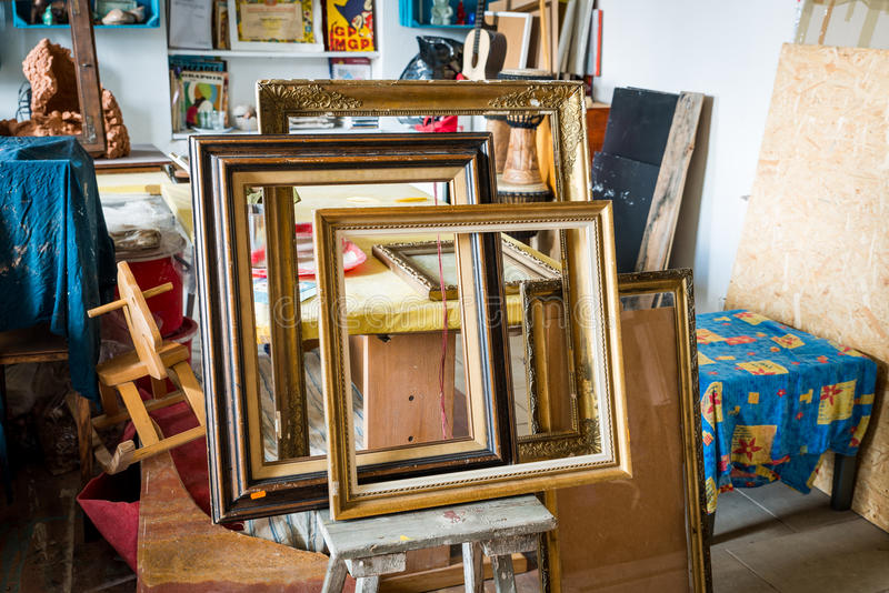 Old paintings frames. Old wooden painting frames in painter studio stock photography