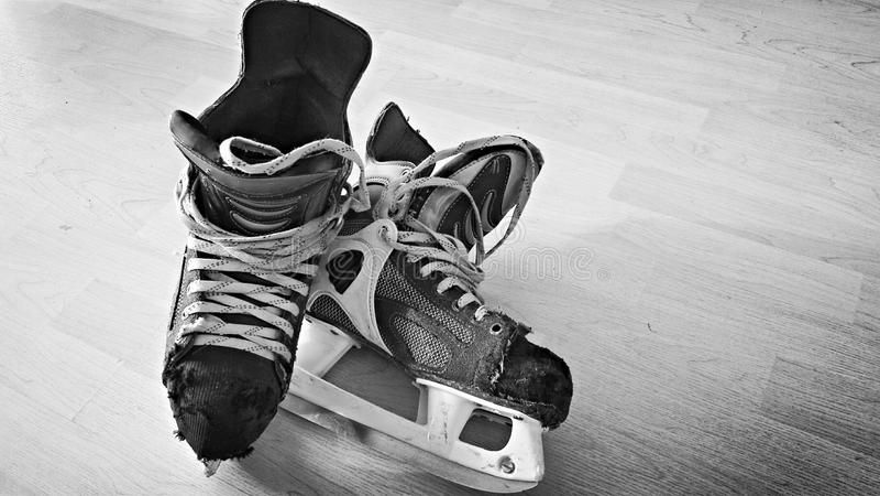 Old pair of hockey skates. Very worn hockey skates, used many times for skating royalty free stock photo