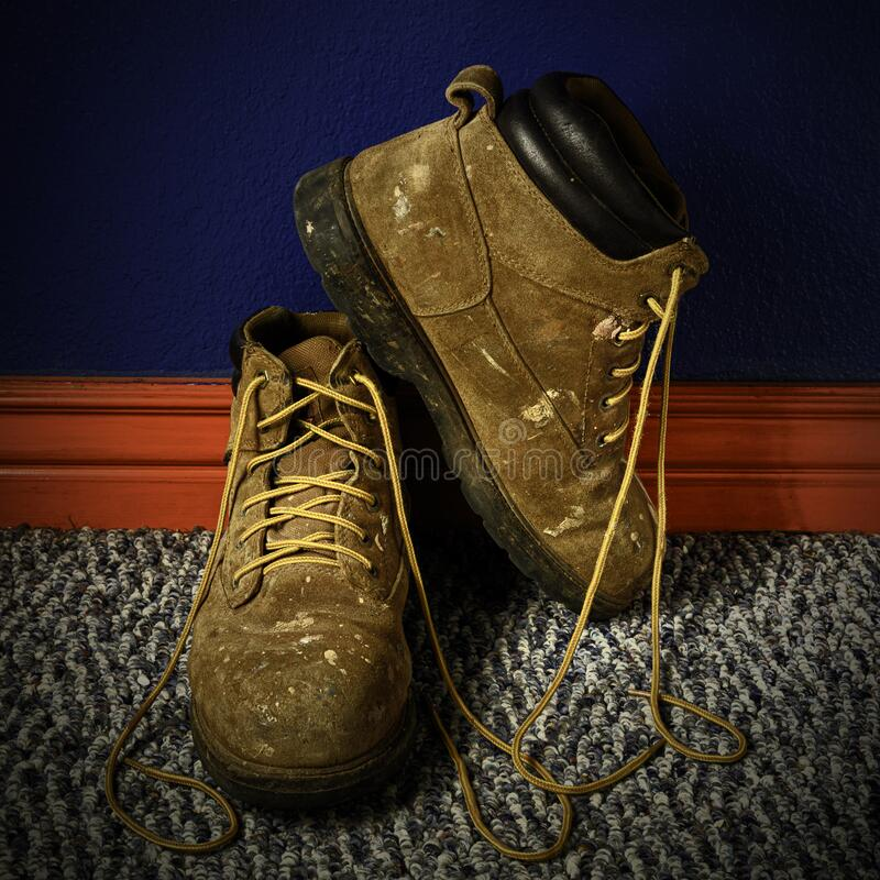Old Pair of Work Boots royalty free stock photos