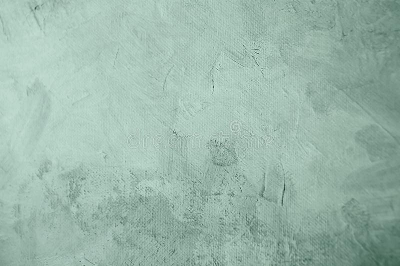 Old pale green canvas painting draft detail, background. Green grungy stained canvas painting draft detail, blank background or texture stock image