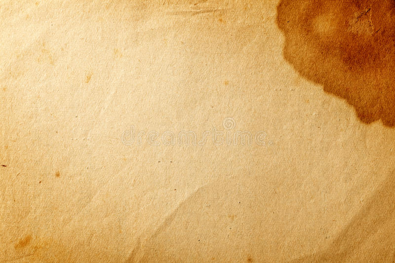 Old paper. Old yellowed paper with brown stain on the corner for background stock images