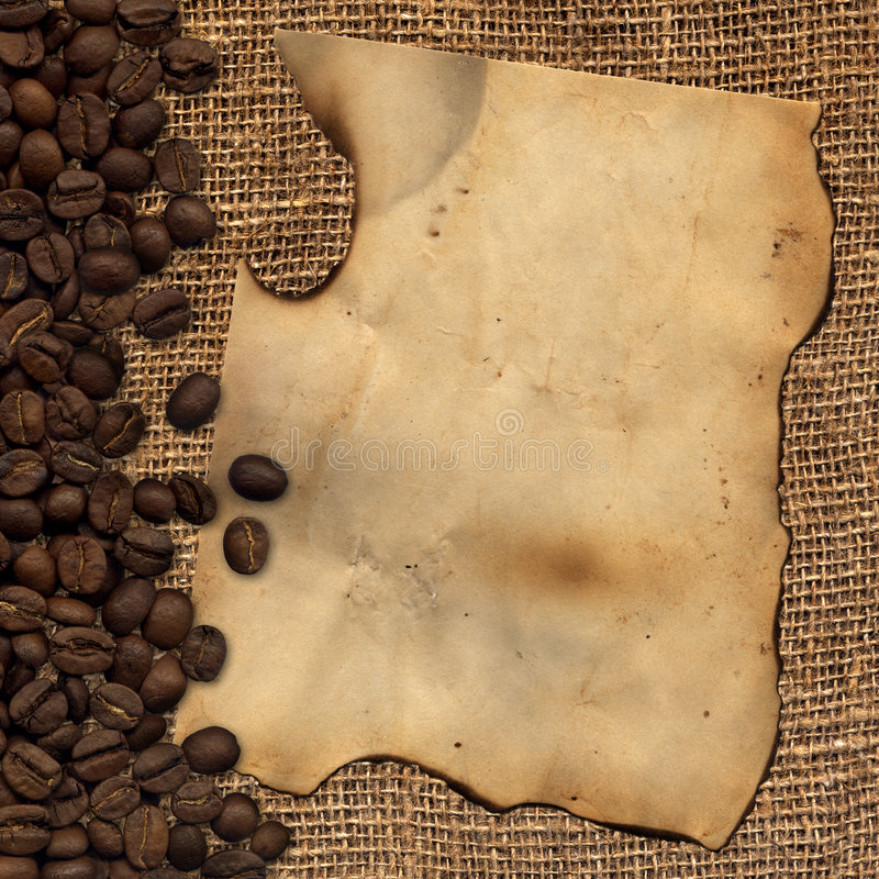 Old paper on background with coffee beans royalty free stock images