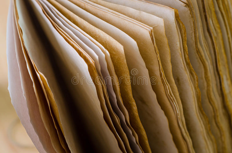 Old paper book. A book with old pages on desk, horizontal royalty free stock photo