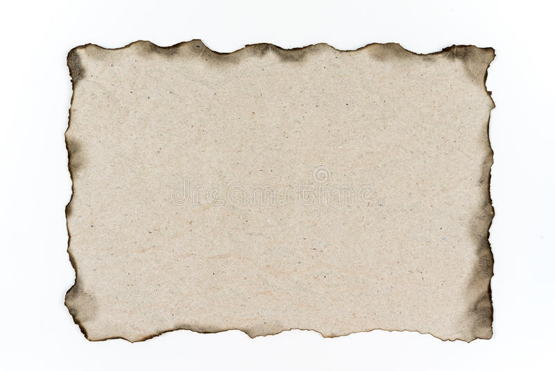 Old Paper with burned edges on white background. stock photo