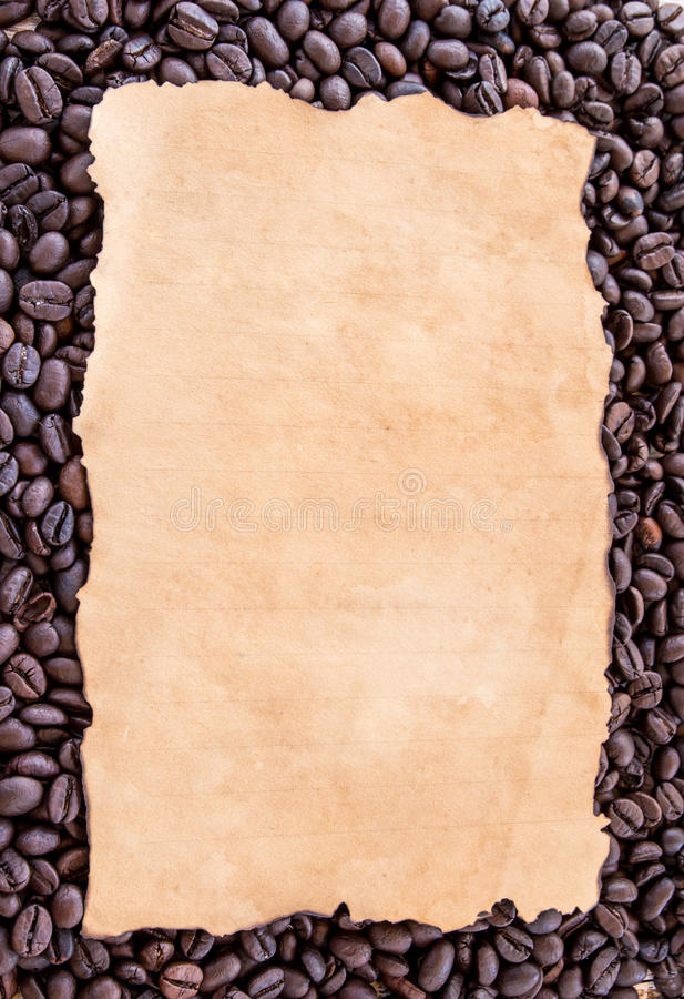 Old paper on coffee beans background royalty free stock photos