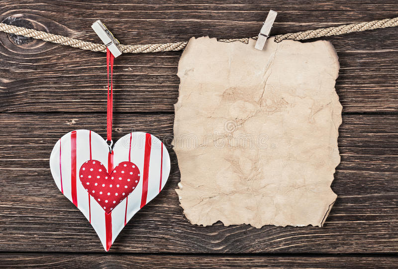 Old paper with heart and place for congratulations. Valentine or Mother's Day royalty free stock photos