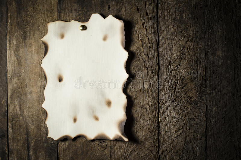 Old paper over wooden background. Old paper over an old wooden background stock photos