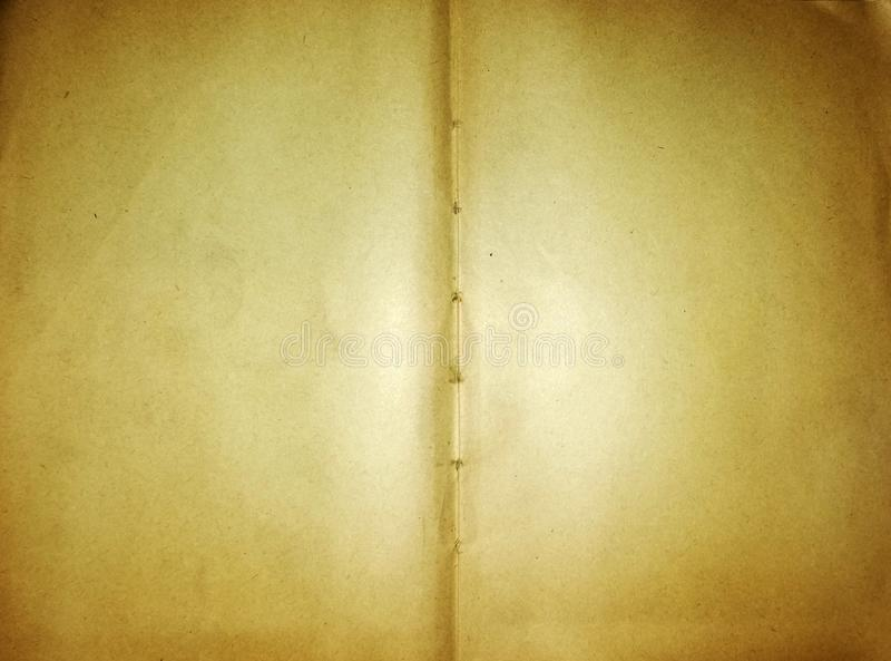 Old notebook paper tied with rope for background and design stock photos