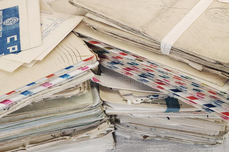 Pile of the old paper postal mails stock images