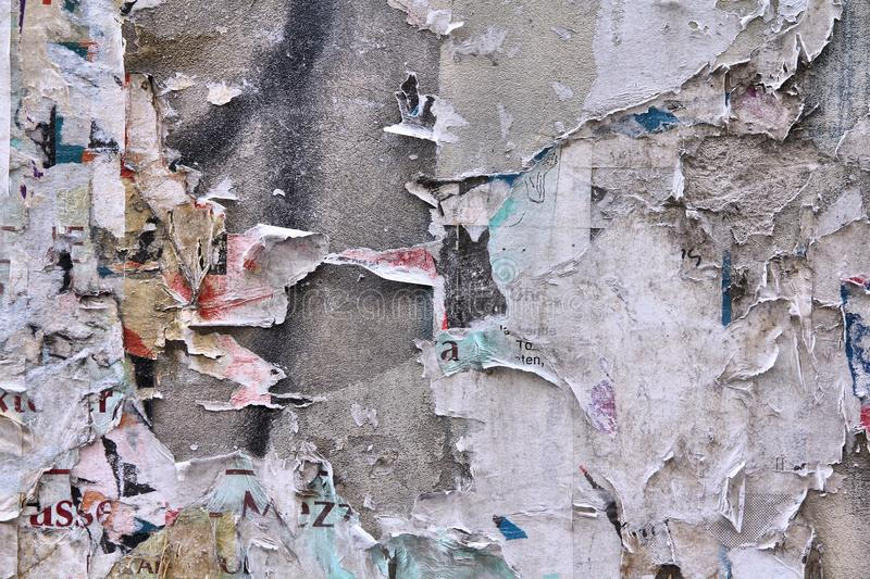 Old posters. Old paper posters and advertisements torn off an urban wall. Background abstract royalty free stock image