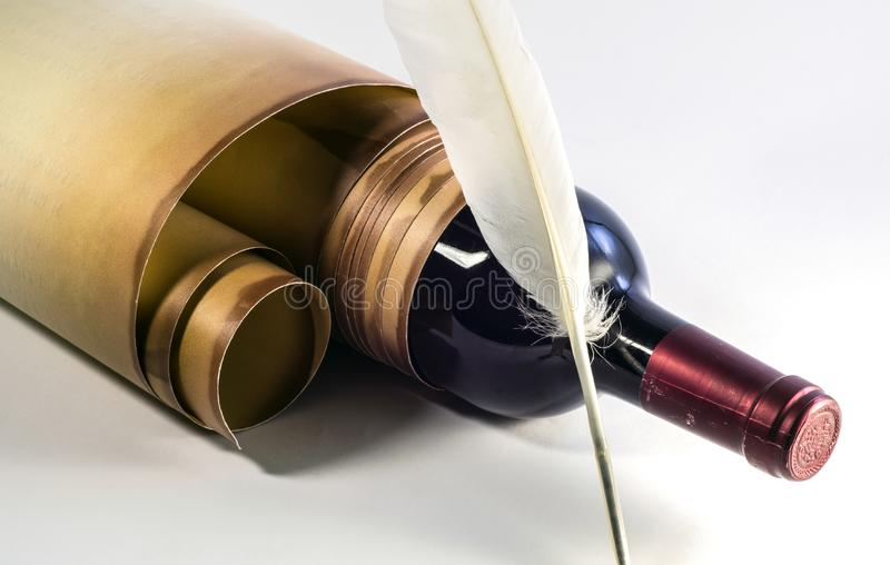 Old paper scroll, bottle of wine, quill pen on a light background. NClose-up. View from above stock image