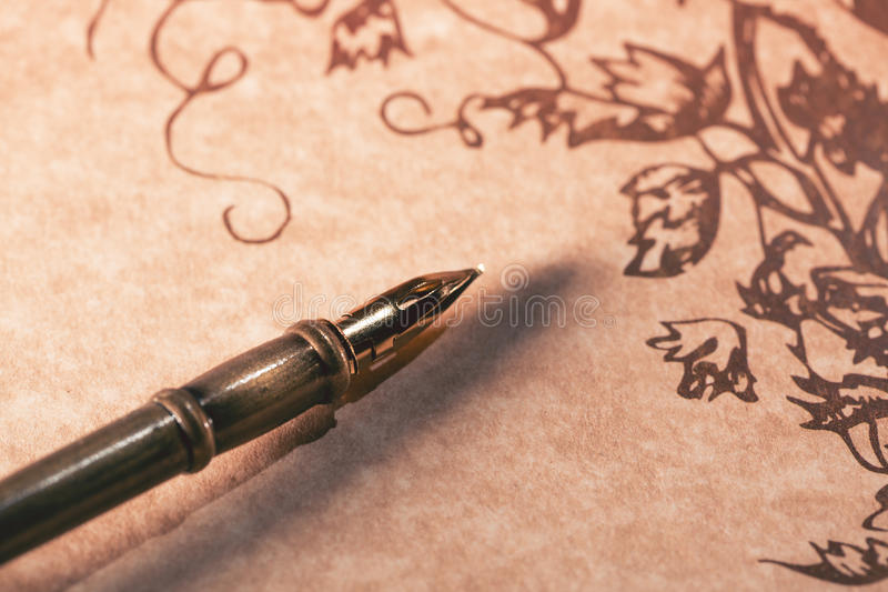 Old paper scroll and fountain pen with selective focus stock image