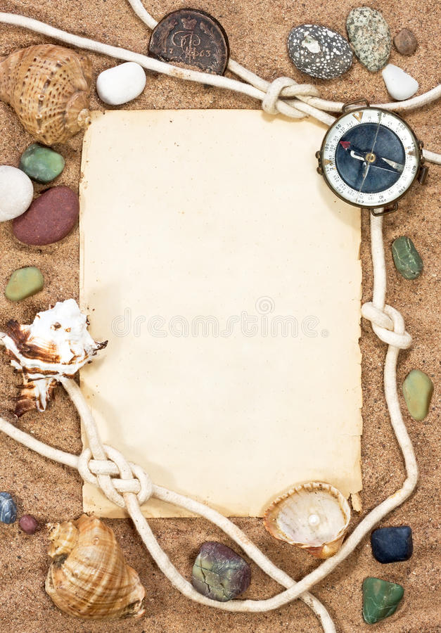 Old paper, sea shells and rope stock photo