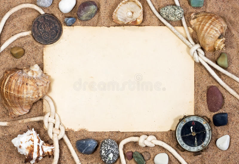 Old paper, sea shells and rope stock photography