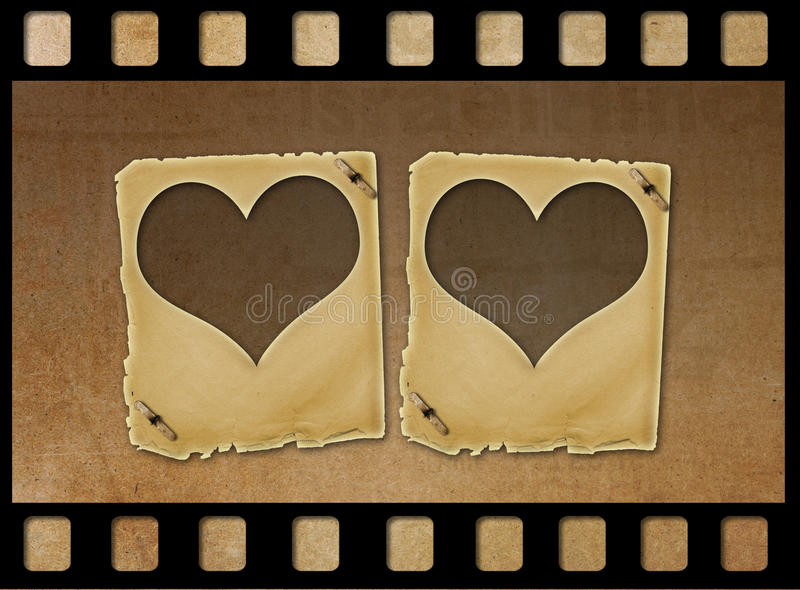 Old paper slides in the form of hearts on grunge background royalty free illustration