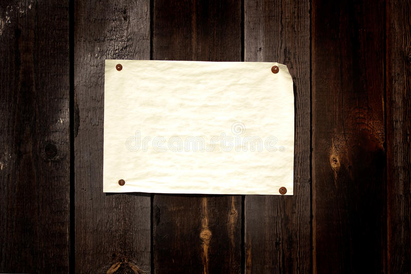 Old paper tacked to a wood wall royalty free stock images
