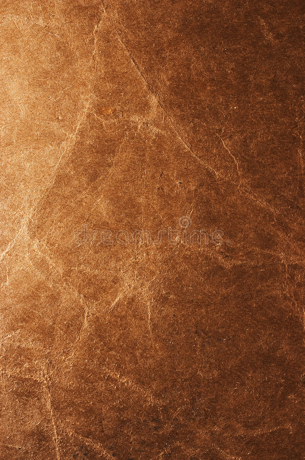 Old paper texture. Old brown paper closeup texture