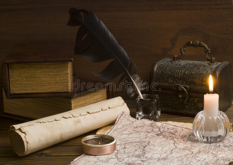 Old papers and books on a wooden table royalty free stock photos