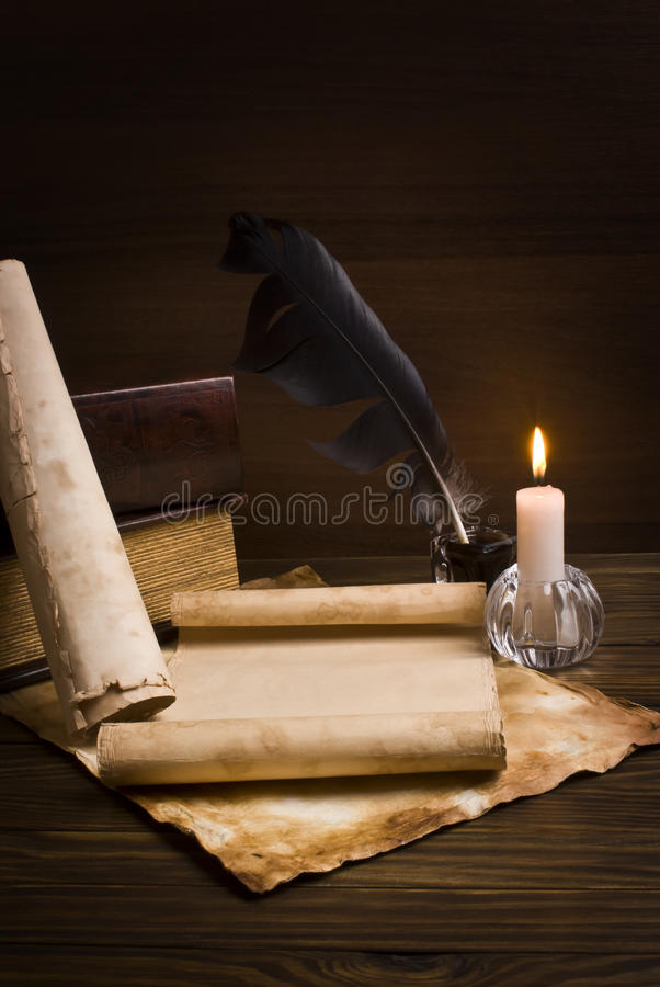 Old papers and books on a wooden table royalty free stock photography
