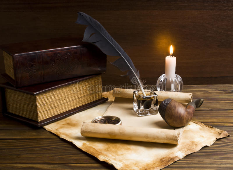 Old papers and books on a wooden table stock image