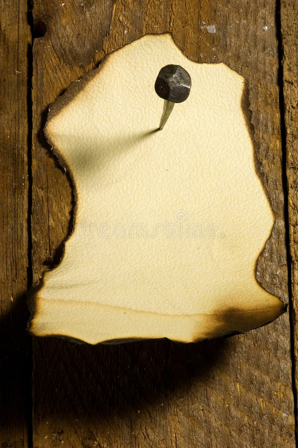 Free Old Papper Pined With A Nail Royalty Free Stock Photography - 6791547