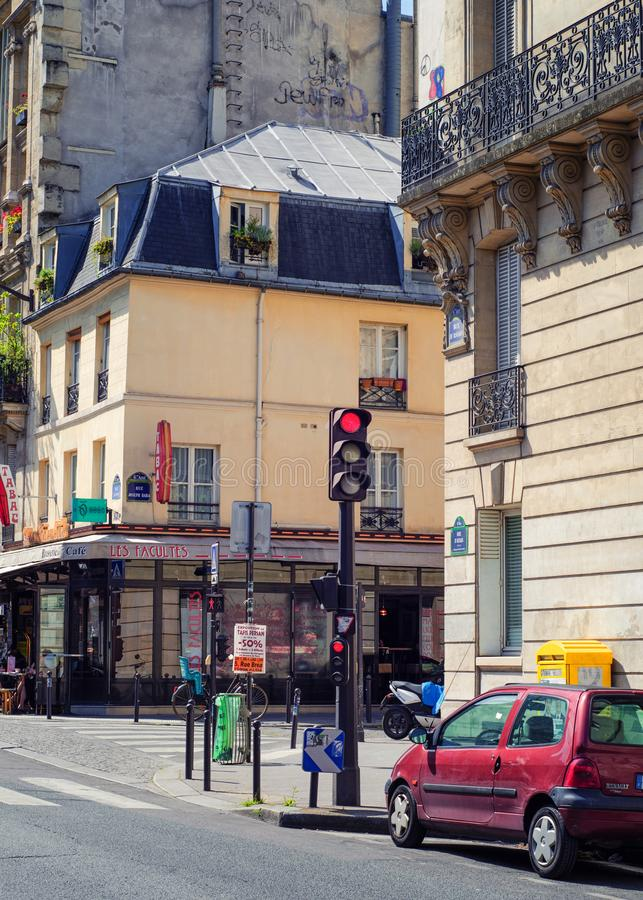 Old Parisian building with cafe in the basement royalty free stock photography