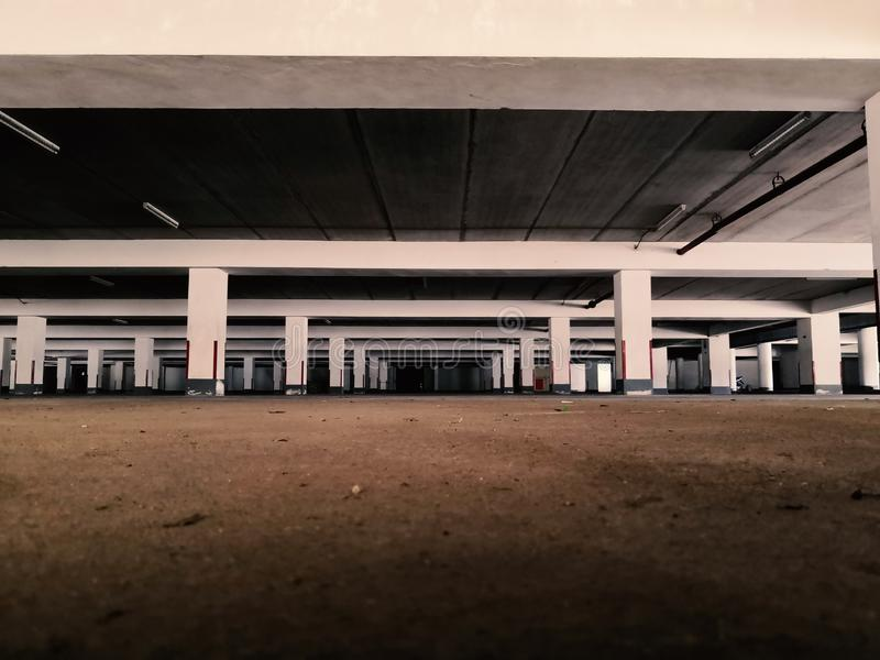 Old parking lot. Under the building stock photography