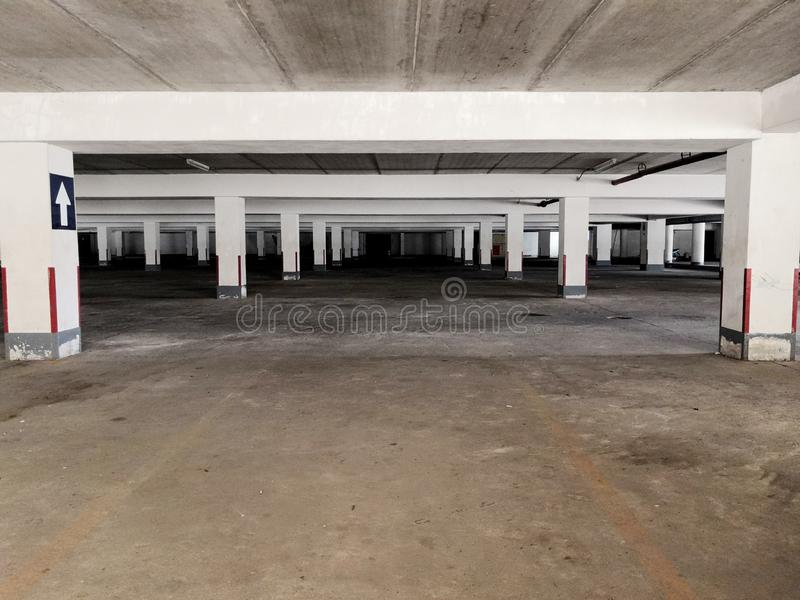 Old parking lot. Under the building royalty free stock photo