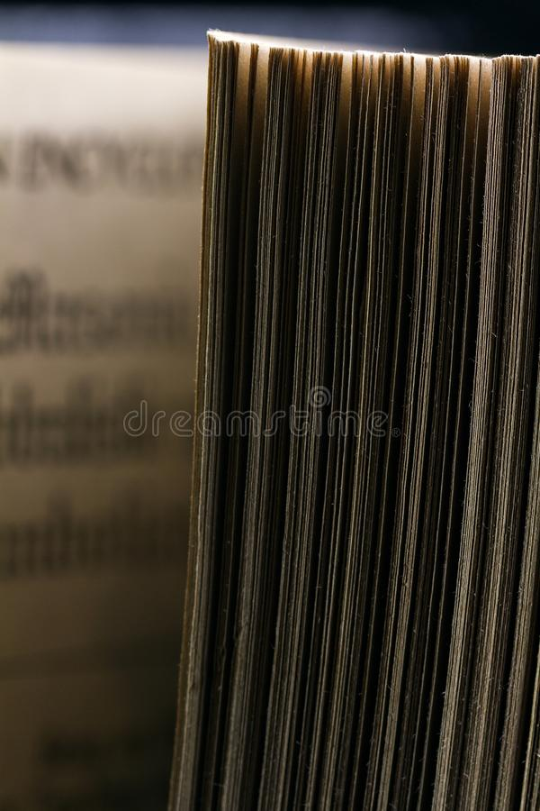 The old parted book is close-up. In the backlight with a clear page texture stock photos
