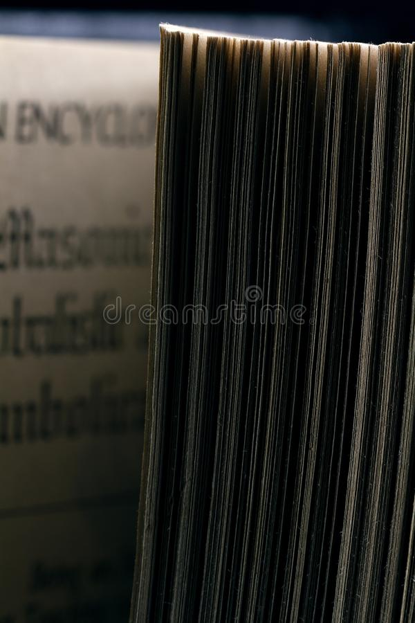 The old parted book is close-up. In the backlight with a clear page texture stock photography
