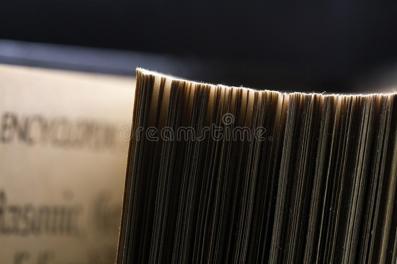 The old parted book is close-up. In the backlight with a clear page texture stock images