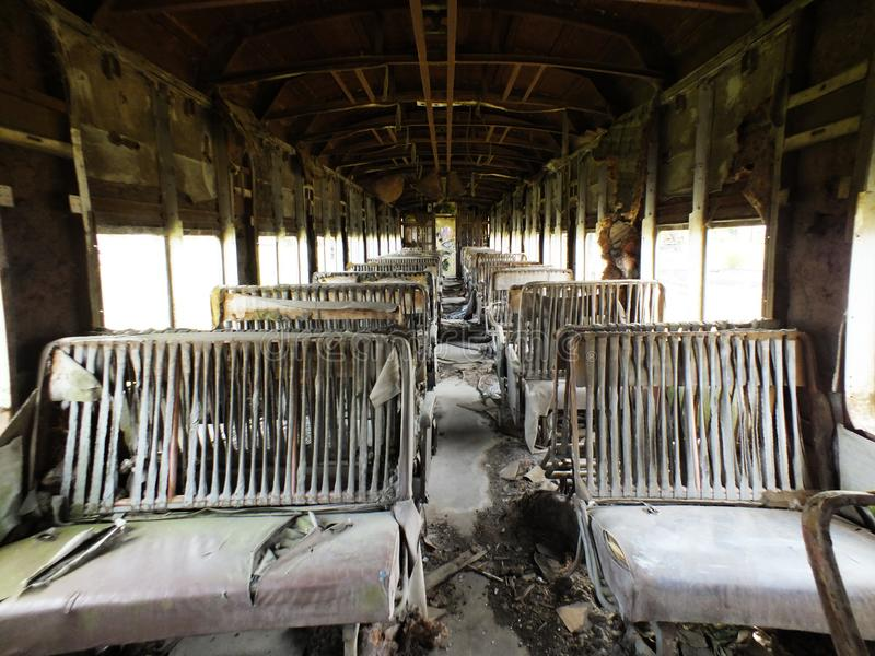 Old passenger car with destroyed seats stock images
