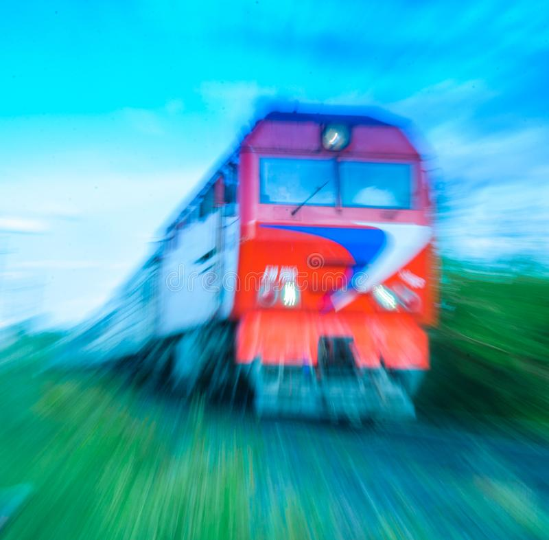Old passenger train with motion blur effect with blur evening sky background. stock photos