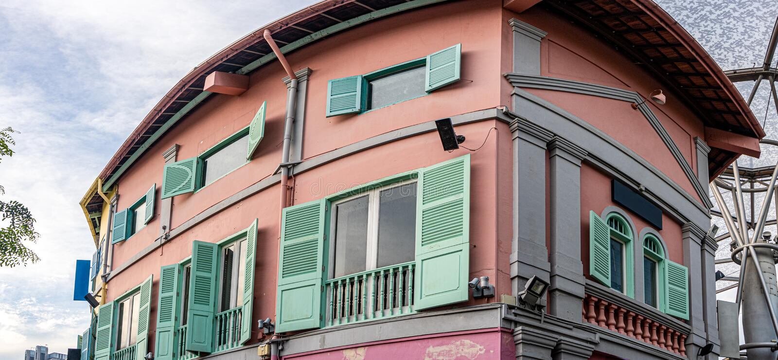 Old pastel color tenement building preserved in Singapore stock photos