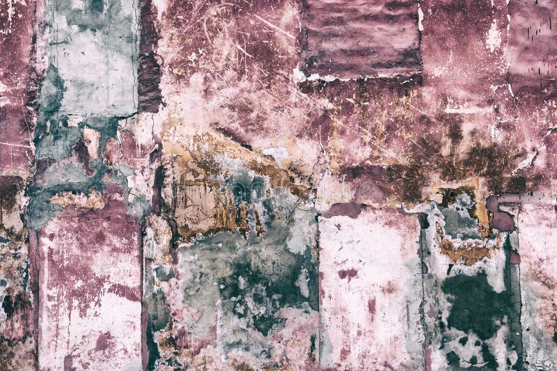Old patched shabby concrete wall grunge background royalty free stock photography