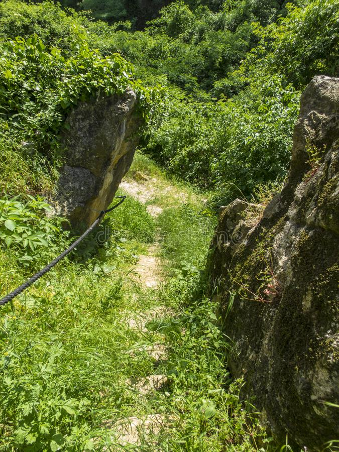 Old path from a cliff and tower in Istria. Old path with tower in Istria near Slowenian border royalty free stock photography