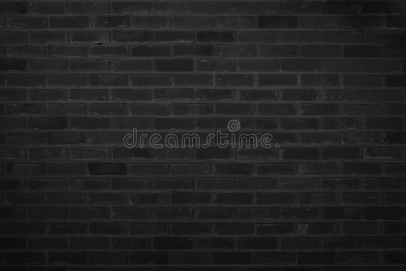 Old pattern stone wall background. Black brick wall abstract. rough solid texture and grunge surface backdrop for architecture ma. Terial decoration or retro royalty free stock photos