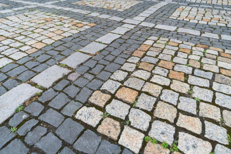 Old paving stones pattern, Texture of ancient german cobblestone in city downtown, Little granite tiles, Antique gray pavements. Old paving stones pattern royalty free stock photos