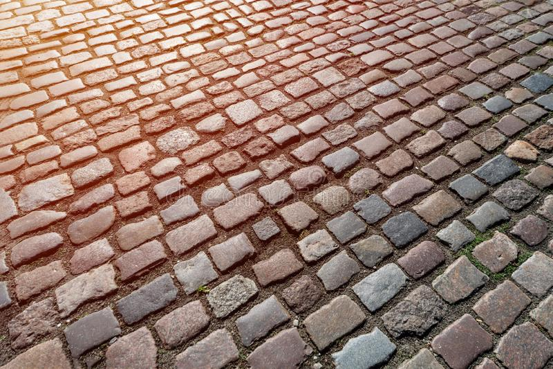 Old paving stones pattern, Texture of ancient german cobblestone in city downtown, Little granite tiles, Antique gray pavements. Old paving stones pattern stock photo