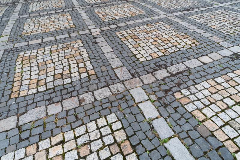 Old paving stones pattern. Texture of ancient german cobblestone in city downtown. Little granite tiles. Antique gray pavements stock image