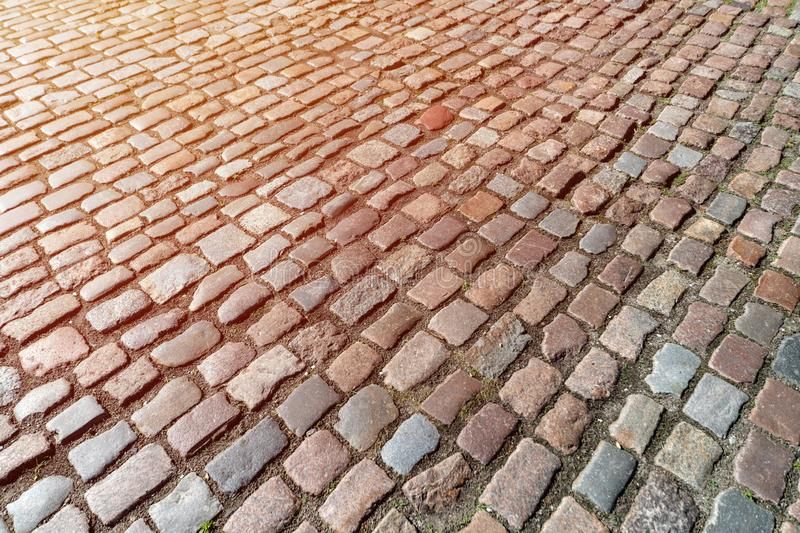 Old paving stones pattern. Texture of ancient german cobblestone in city downtown. Little granite tiles. Antique gray pavements royalty free stock photography