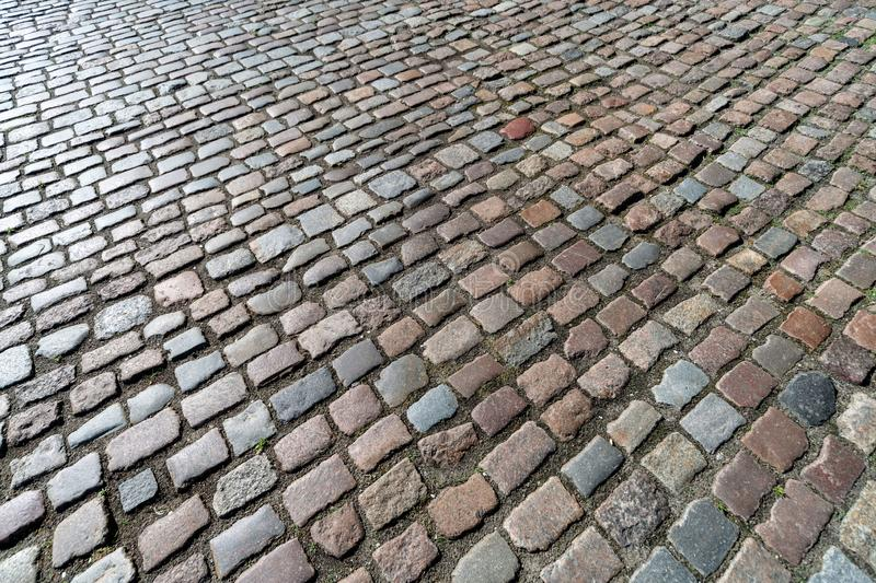 Old paving stones pattern. Texture of ancient german cobblestone in city downtown. Little granite tiles. Antique gray pavements royalty free stock photos