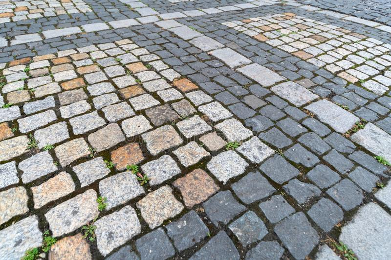 Old paving stones pattern. Texture of ancient german cobblestone in city downtown. Little granite tiles. Antique gray pavements stock photography