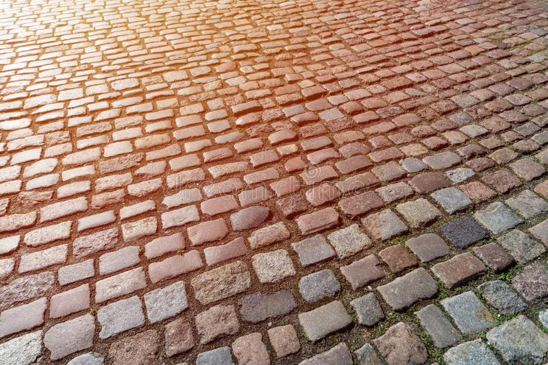 Old paving stones pattern. Texture of ancient german cobblestone in city downtown. Little granite tiles. Antique gray pavements royalty free stock photo