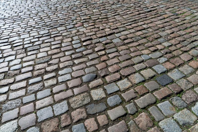 Old paving stones pattern. Texture of ancient german cobblestone in city downtown. Little granite tiles. Antique gray pavements stock photos