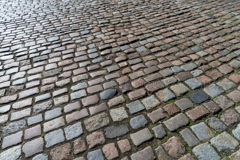 Old paving stones pattern. Texture of ancient german cobblestone in city downtown. Little granite tiles. Antique gray pavements stock photo