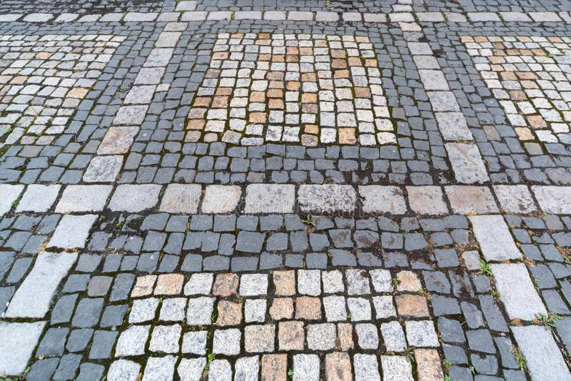 Old paving stones pattern. Texture of ancient german cobblestone in city downtown. Little granite tiles. Antique gray pavements royalty free stock image